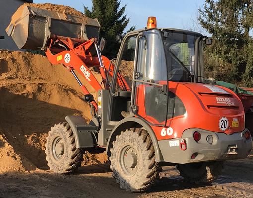 Grimmert-Recycling - Schüttgüter |Radlader mit Sand